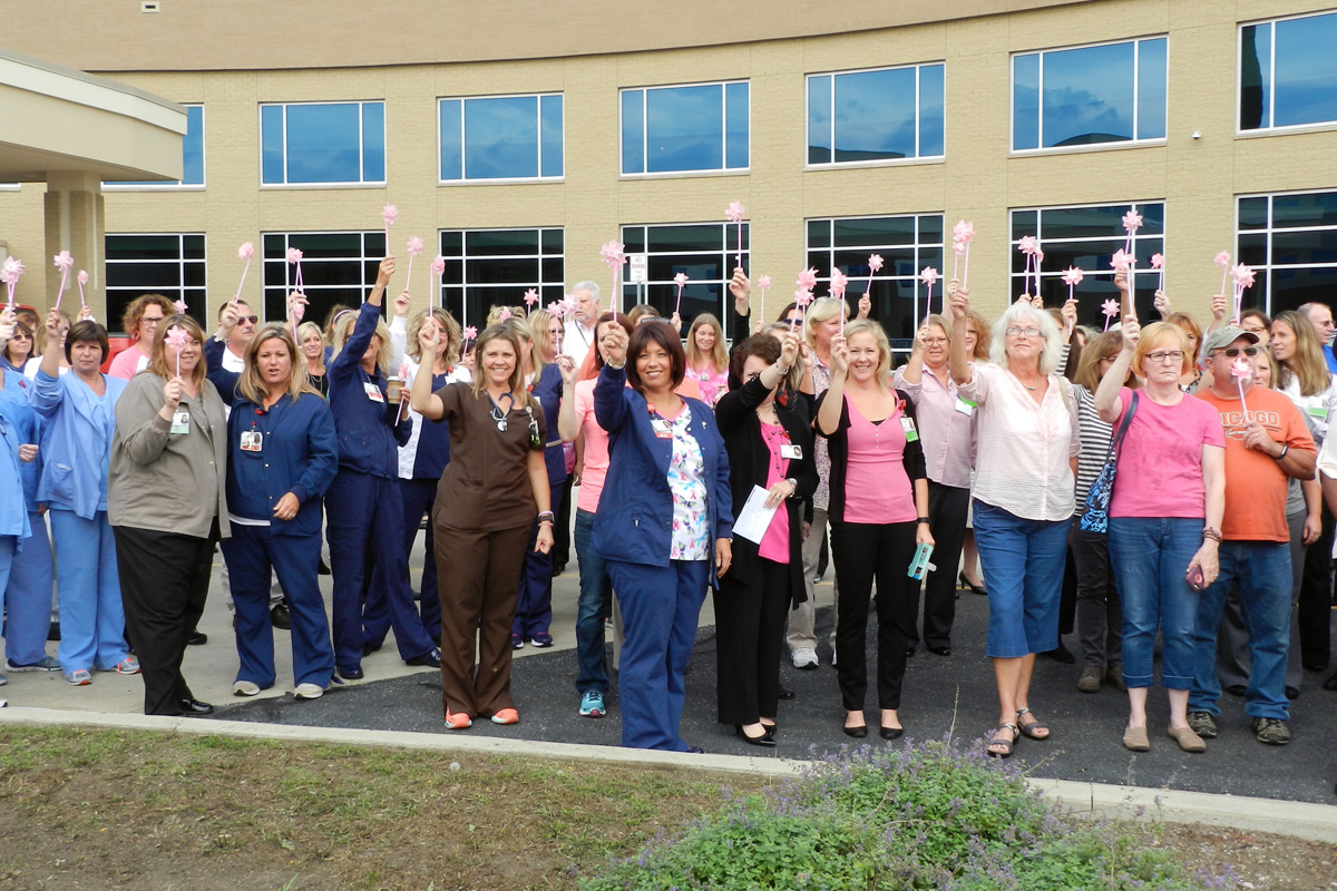 """Breast Cancer Survivors Gather at Porter Regional Hospital to """"Blow Away Breast Cancer"""" with Flag Raising"""